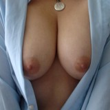 Kittys huge tits are hanging out of her unbuttoned dress shirt